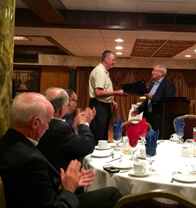 State Senator Steve Cassano congratulates Barry Stearns.