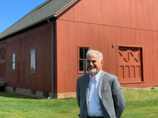 P&Z chair Adam Teller with Heritage Farm barn in background
